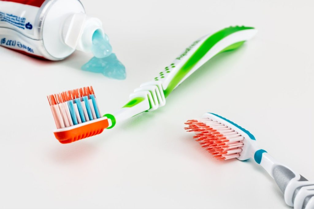 Colorful toothbrushes and toothpaste