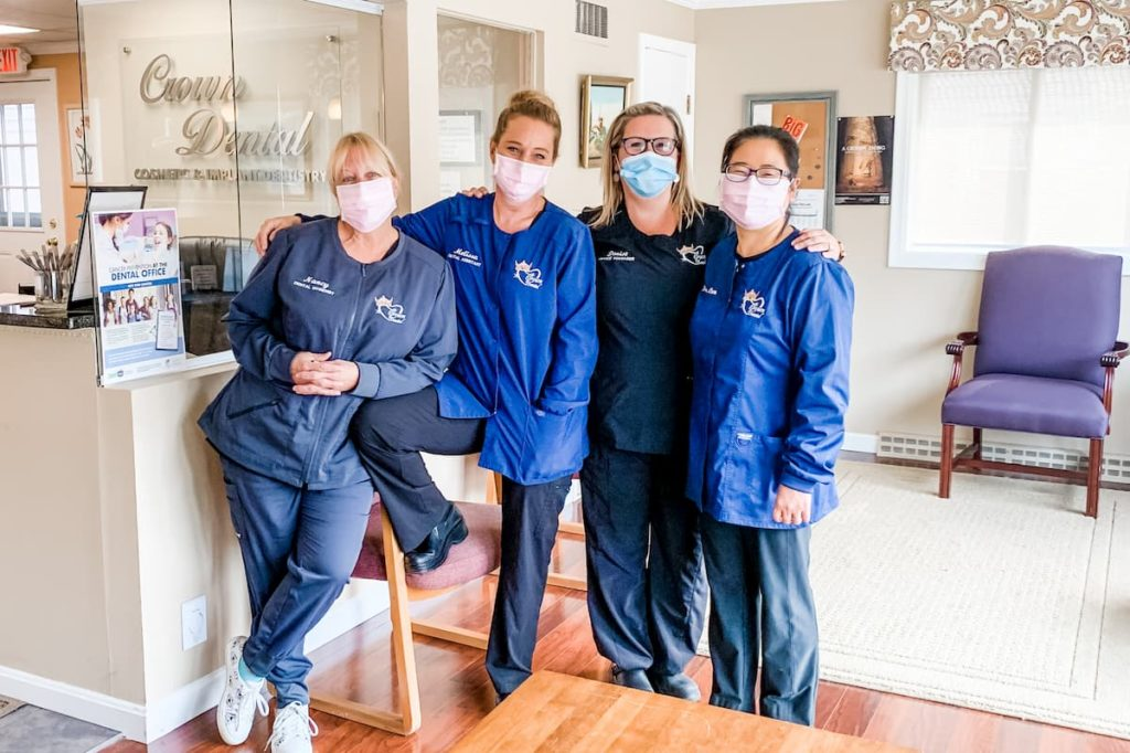 Dr. Jennifer Chen and the other three team members of Crown Dental