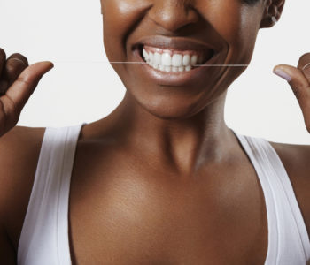 woman with a dental floss